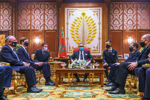 King Mohammed VI (C), flanked by his son Crown Prince Moulay Hassan (C R), meets with US Presidential advisor Jared Kushner (2nd L) and Israeli National Security Advisor Meir Ben Shabbat (L) at the Royal Palace in Rabat