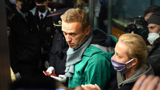 Russian opposition leader Alexei Navalny and his wife Yulia are seen at the passport control point at Moscow's Sheremetyevo airport on January 17, 2021