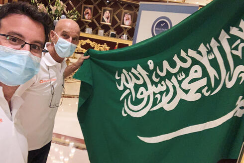 Omer Pearl and driver Danny Pearl take a selfie with a flag before the begining of the Dakar Rally, in a hotel in Jeddah, Saudi Arabia