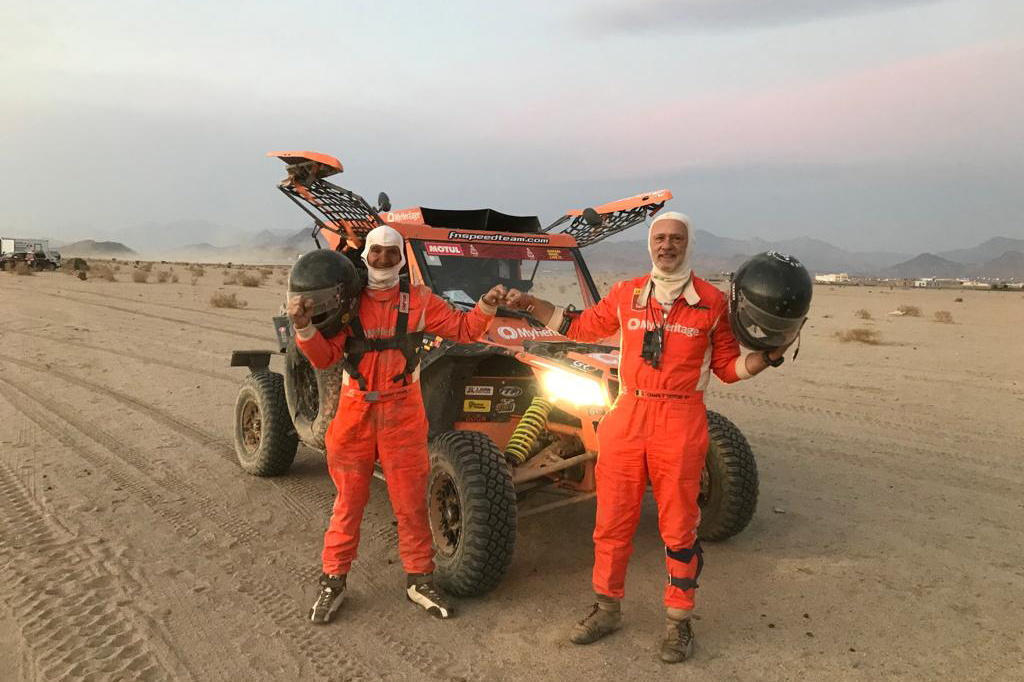 Driver Danny Pearl and co-driver Charly Gotlib, stand by their Lightweight Vehicle Prototype, as they take part in the Dakar Rally, Saudi Arabia