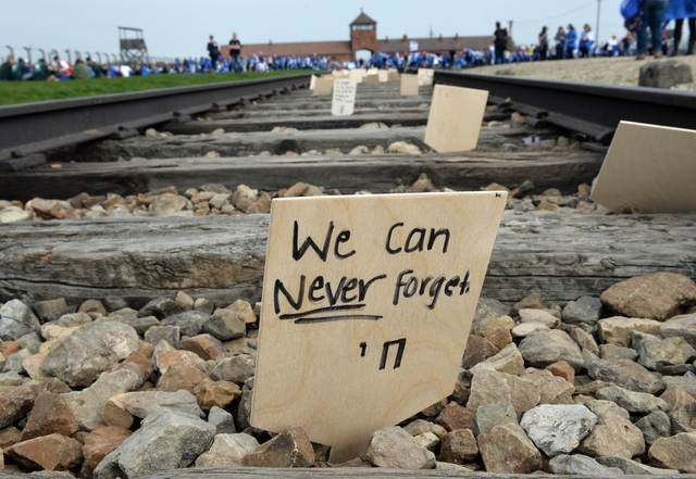 A sign is seen on the tracks at the former Nazi German Auschwitz-Birkenau death camp during the 'March of the Living' in 2015