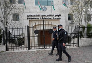 Palestinian policemen outside the Palestinian Legislative Council in Ramallah