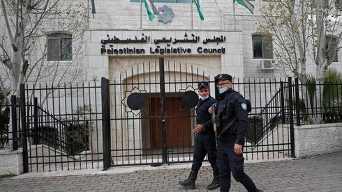 Palestinian policemen guard outside the Palestinian legislative council in Ramallah, in the Israeli-occupied West Bank, Jan. 16, 2021.
