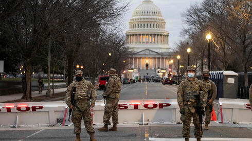 Members of the U.S. National Guard stand watch at the US Capitol in Washington