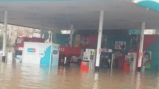 Flooding at a gas station in Nesher