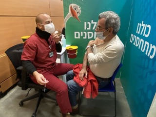 A man vaccinated for coronavirus at a medical center in northern Tel Aviv