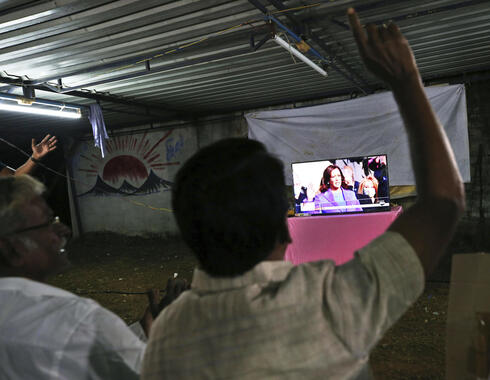 Villagers in Thulasendrapuram, the hometown of Kamala Harris' maternal grandfather, celebrate as they watch a live telecast of her being sworn in as U.S. vice president, Jan. 20, 2021