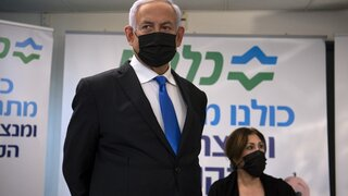 Prime Minister Benjamin Netanyahu visits a coronavirus vaccination facility in the northern Arab city of Nazareth