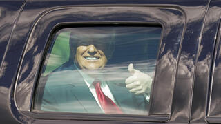 Trump gives thumbs up to his supporters after election loss