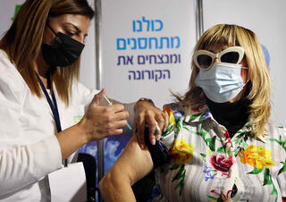Health worker administers COVID-19 vaccine in Jerusalem