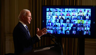 U.S. President Joe Biden talks to staff members remotely from the White House after he was sworn in on Wednesday