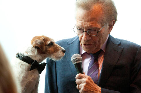 Larry King interviews Uggie, the dog from the film 'The Artist, in New York, May 2012