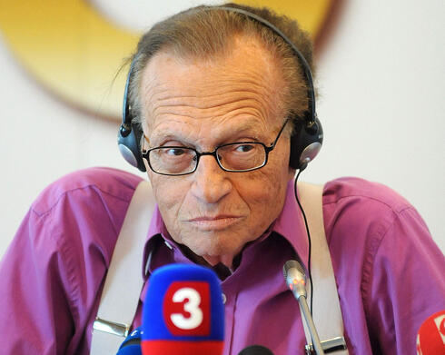 Larry King answers journalists' questions during a press conference in Slovakia, Sept. 2011
