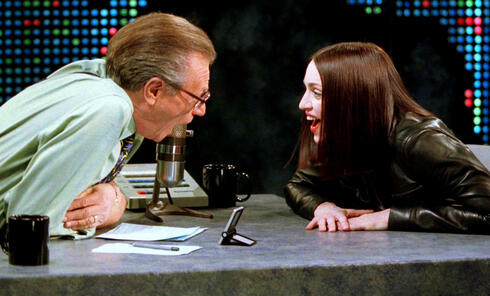Singer Madonna shares a laugh with Larry King on the set of the CNN talk show 'Larry King Live' in New York City, Jan. 1999