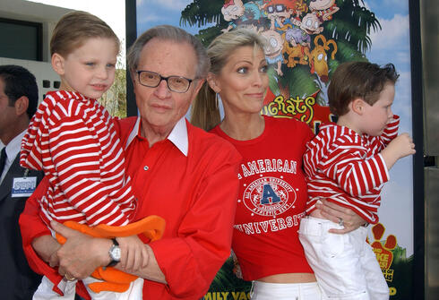Larry King and his wife Shawn Southwick with their sons Chance and Cannon arrive for the premiere of 'Rugrats Go Wild' in Los Angeles, June 2003