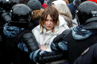aw enforcement officers detain a woman during a rally in support of jailed Russian opposition leader Alexei Navalny