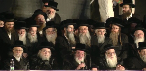 Rabbi Israel Hager, head of the Vizhnitz Hassidic dynasty (holding a microphone) with members of his flock