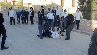 ultra-Orthodox clash with police outside a religious seminary in Ashdod operating in violation of coronavirus lockdown restrictions