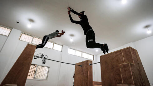 alestinian youths train at the Wallrunners Parkour Academy's training facility in Gaza