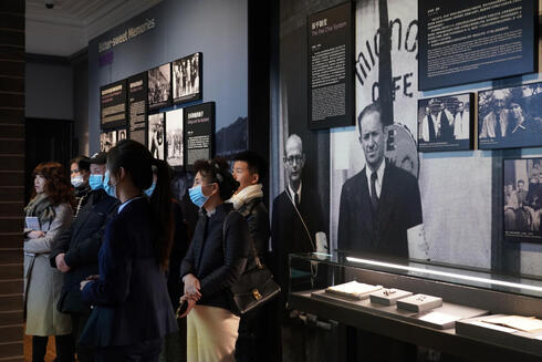 people visiting an exhibition hall at the Shanghai Jewish Refugees Museum