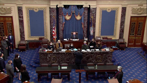 Jamie Raskin (D-MD) hands over the House article of impeachment against former President Donald Trump on accusations of inciting the January 6 attack on the Capitol, on the floor of the U.S. Senate