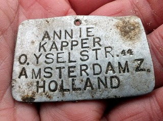 A name tag of a child found during excavations at Sobibor death camp in Poland