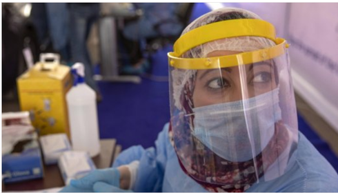 A health professional in Egypt tests for coronavirus in Cairo