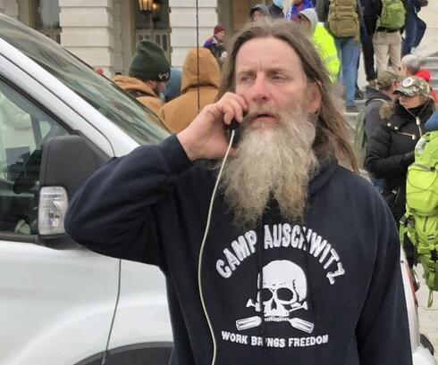 A Trump supporter wearing a 'Camp Aushwitz' jacket during the attack on the U.S. Capitol on Jan. 6
