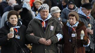 survivors of the Nazi death camp Auschwitz arrive for a commemoration ceremony on International Holocaust Remembrance Day at the International Monument to the Victims of Fascism inside Auschwitz-Birkenau in Oswiecim, Poland