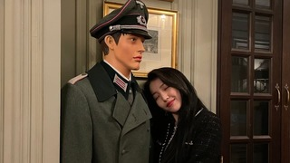 South Korean K-pop singer Sowon poses flirtatiously with a mannequin dressed in Nazi military uniform