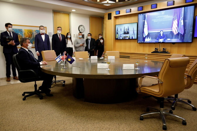 Foreign Minister Gabi Ashkenazi and Kosovo's Foreign Minister Meliza Haradinaj Stublla attend a virtual ceremony to sign an agreement establishing diplomatic relations between Israel and Kosovo in the Israeli foreign ministry in Jerusalem