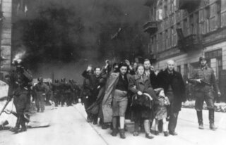 A group of Polish Jews are led to deportation by German SS troops