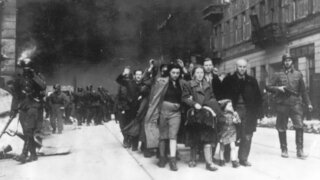 A group of Polish Jews led to deportation by German SS troops