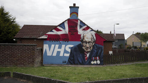 A mural depicting 100 year old army veteran and NHS fund raiser Captain Tom Moore
