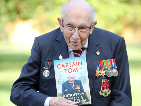Captain Sir Tom Moore poses during a photocall to mark the launch of his memoir 'Tomorrow Will Be A Good Day' at The Coach House in Milton Keynes, Sept. 2020