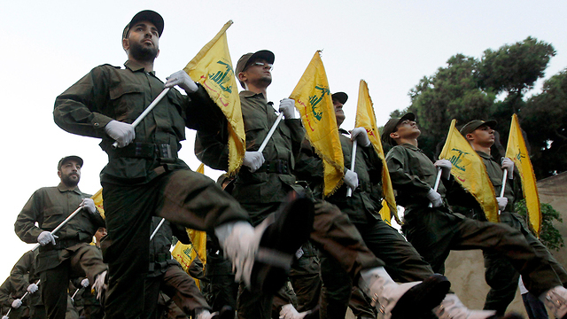 Hezbollah fighters marching in Lebanon