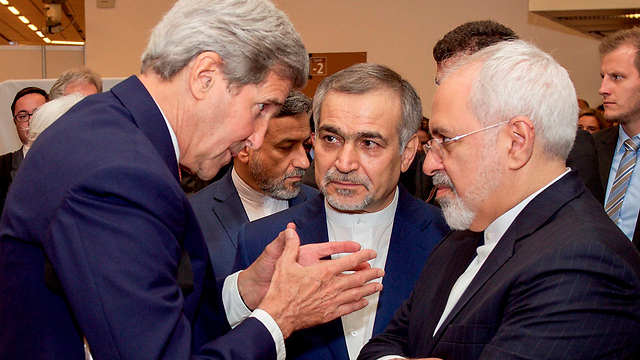 Then U.S. Secretary of State John Kerry meeting with his Iranian counterpart Mohammad Javad Zarif in 2015