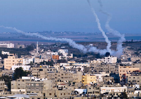 In this file photo taken on August 21, 2014 smoke trails mark the path of Palestinian missiles fired from the north-east of Gaza City