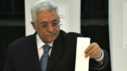 Palestinian President Mahmoud Abbas, casts his ballot in the Palestinian Parliamentary elections at his headquarters in the West Bank town of Ramallah