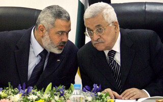 Palestinian Authority President Mahmoud Abbas, right, and then Palestinian Prime Minister Ismail Haniyeh of Hamas, left,
