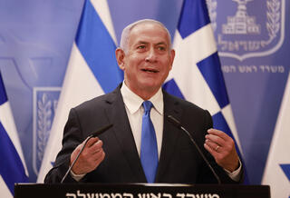 Prime Minister Benjamin Netanyahu speaking to reporters on Monday night in Jerusalem