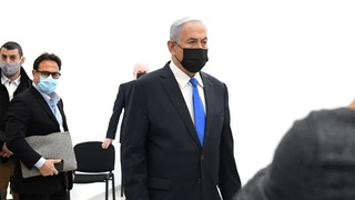 Prime Minister Benjamin Netanyahu arrives at the Jerusalem District Court for his criminal trial on corruption charges