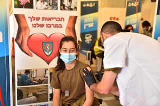 An IDF soldier receives the coronavirus at Tzrifin military base in central Israel