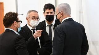 Netanyahu consults with his team at the court in Jerusalem