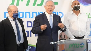 Prime Minister Benjamin Netanyahu urges Israelis to get vaccinated during a press conference in a vaccination center
