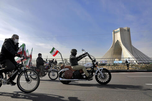 Iranians ride bicycles and motorbikes at a rally in Tehran to mark the 42nd anniversary of the Islamic Revolution, Feb. 10, 2021