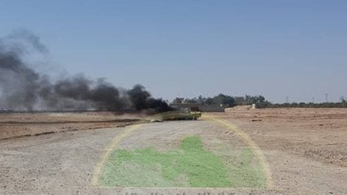An image of the purported attack near the Syria-Iraq border shows a burning car
