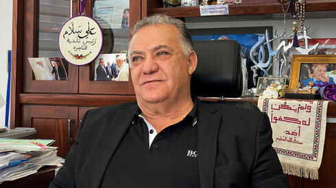 Ali Salam, mayor of Nazareth sits in his office