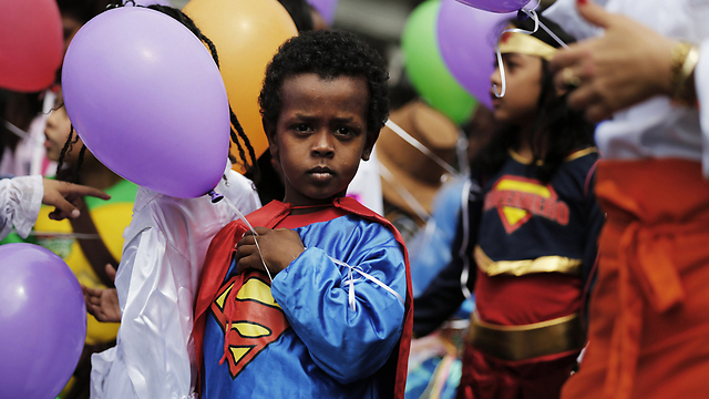 A child dressed as Superman celebrates a previous Purim in Tel Aviv