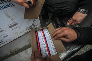 Palestinian Health employees receive Covid-19 vaccines after a shipment